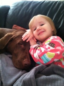 a strong relationship between a kid and her dog