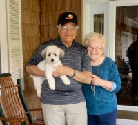 older couple with their little white dog